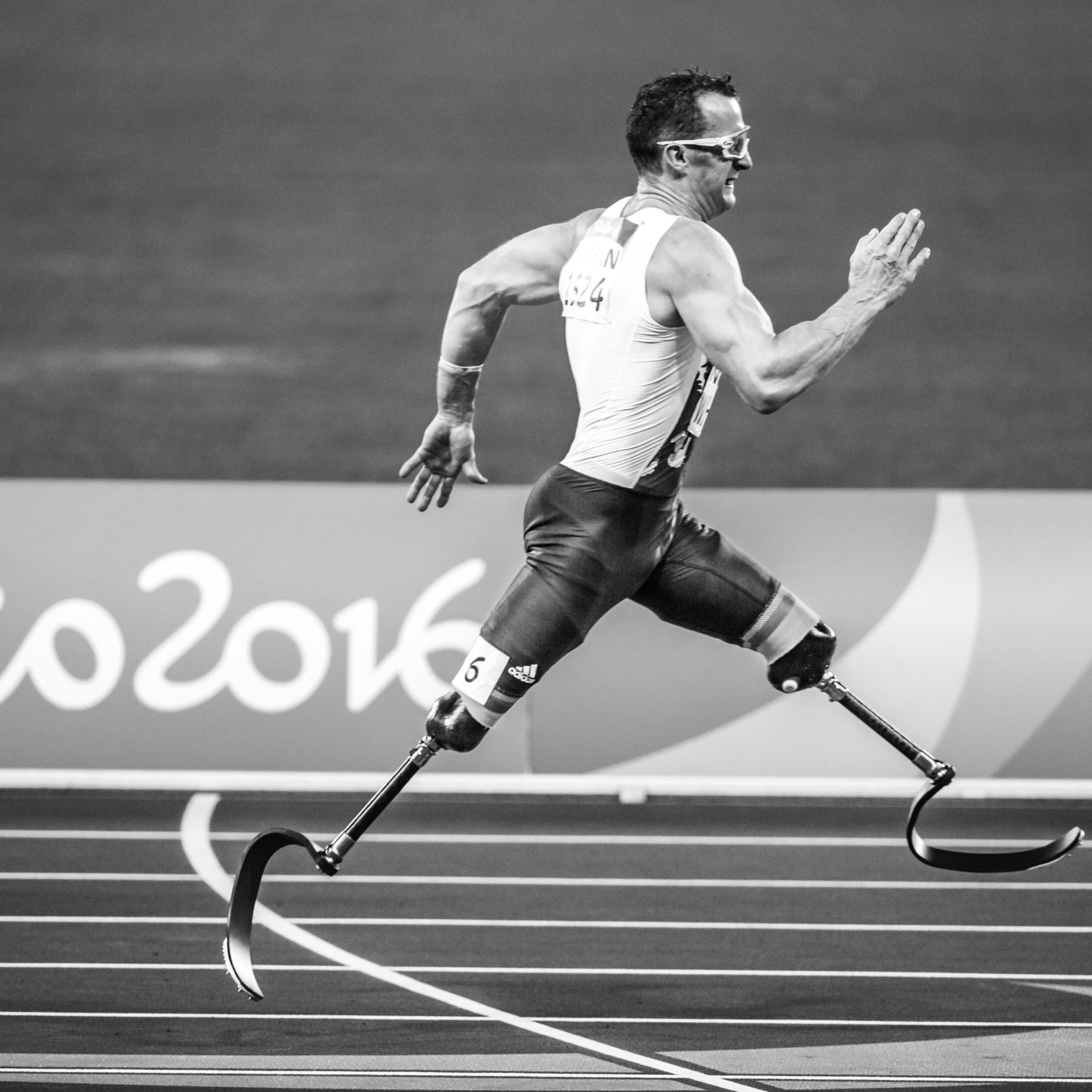 Canva - Man with Leg Prosthesis Running at Rio 2016 Olympics